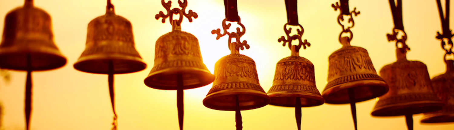 Nepaly traditional Bells over the sun at sunset